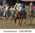"SARATOGA SPRINGS - JUL 21: The field takes the club house turn in the Coaching Club American Oaks on Jul 21, 2012 in Saratoga Springs, NY. Eventual winner is ""Questing"" (blue silks). - stock photo"