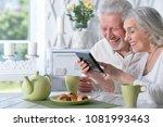 senior couple using tablet... | Shutterstock . vector #1081993463