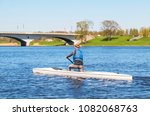 Small photo of girl canoeist on the river by canoe