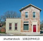 brick building with red door | Shutterstock . vector #1082094413