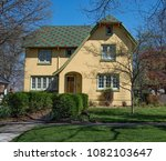 yellow stucco house with... | Shutterstock . vector #1082103647