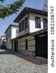 Small photo of Blagoevgrad, Bulgaria - March 17, 2018: Ancient residential district with narrow alley and authentic architecture from hoary antiquity Varosha, Blagoevgrad, Bulgaria. Visit in place.