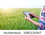 smart agriculture. farmer in... | Shutterstock . vector #1082126567