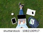top view of girl sitting in... | Shutterstock . vector #1082130917