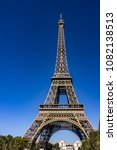 Small photo of Wonderful view of Eiffel Tower (La Tour Eiffel). Eiffel Tower is tallest structure in Paris and most visited monument in world. Champ de Mars, Paris, France.