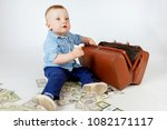 a child adds up dollars. the... | Shutterstock . vector #1082171117