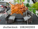 pig roast  barbecued suckling... | Shutterstock . vector #1082402003