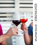 two wineglasses of red and rose ... | Shutterstock . vector #1082461433