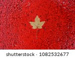 maple leaf on the red road as a ... | Shutterstock . vector #1082532677