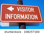 Visitor Information sign against blue sky - stock photo
