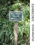 Small photo of Metal Wheelchair Access Sign In Country Garden