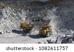 heavy excavator loads ore in...   Shutterstock . vector #1082611757