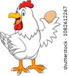 cartoon hen holding a egg | Shutterstock .eps vector #1082612267