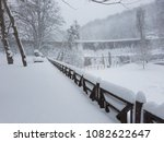 Small photo of Belgrad Forest and Aqueduct, the ennobled vast territory of a large famous park in Istanbul, Turkey, winter. A snow-benched bench, branched trees, a wooden fence, stone slopes of hills, winter.