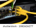 yellow lan cable connect to... | Shutterstock . vector #1082626277