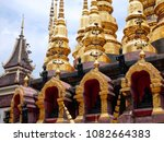 Small photo of Phrae, Thailand - May 5 2018 : Beautiful golden and black color Che Di with blue sky background of Wat Phra That Suthon Mongkhon Khiri