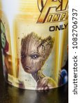Small photo of MINSK, BELARUS - MAY 3, 2018: Groot on the souvenir cup of the Marvel's film Avengers: Infinity War in the Galileo cinema