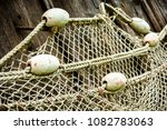 old fishing net at a harbor | Shutterstock . vector #1082783063