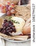 Small photo of Baked brie with cranberries and fresh rye bread