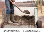 a man with a shovel in his... | Shutterstock . vector #1082863613