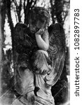 Small photo of angel of death as a symbol of the end of life. Retro styled photo of ancient statue.