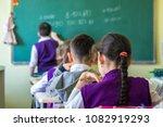 school children are... | Shutterstock . vector #1082919293