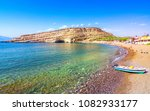 Small photo of Matala beach with caves on the rocks that were used as a roman cemetery and at the decade of 70's were living hippies from all over the world, Crete, Greece
