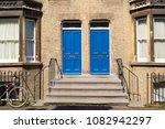 two identical blue wooden front ... | Shutterstock . vector #1082942297