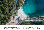 aerial view of marble beach.... | Shutterstock . vector #1082946167