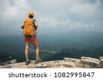 successful woman hiker hiking... | Shutterstock . vector #1082995847