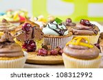 A selection of freshly made cupcakes. - stock photo