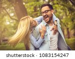 happy young couple in park... | Shutterstock . vector #1083154247