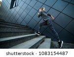 female athlete running fast up... | Shutterstock . vector #1083154487