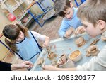 group of children shaping clay... | Shutterstock . vector #108320177