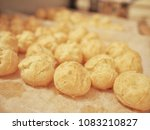 Small photo of A puff pastry shell or profiteroles on the parchment paper ready to fill with custard cream as sweet or other fillings as savoury.
