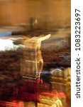 Small photo of image of Jesus Christ crucified, unretouched photo, Impressionist artistic photograph of the Holy Week in Toledo, 218. Spain, with controlled movements of the camera to suggest emotions and fervor.