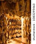 iberian cured hams stored in a... | Shutterstock . vector #1083295463