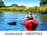 Girl With Paddle And Kayak On ...