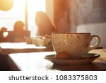 cup of hot coffee on table in...   Shutterstock . vector #1083375803