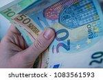 female hand holding euro bank... | Shutterstock . vector #1083561593