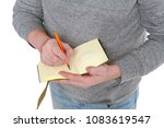 man writes in a vintage notepad ... | Shutterstock . vector #1083619547