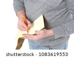 man writes in a vintage notepad ... | Shutterstock . vector #1083619553