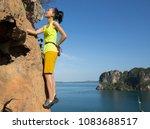 female rock climber climbing on ... | Shutterstock . vector #1083688517