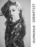 girl with long hair wears black ... | Shutterstock . vector #1083697157