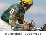 SARATOGA SPRINGS - JUL 21: Jockey Junior Alvarado reins in his mount after competing in an allowance race at Saratoga Race Course on Jul 21, 2012 in Saratoga Springs, NY. - stock photo