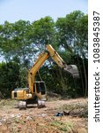 Small photo of Yellow Crawler Backhoe clear Landscape