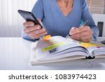 close up of a woman using... | Shutterstock . vector #1083974423