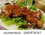 close up of roasted suckling pig | Shutterstock . vector #1083978767