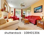 Cozy classic peach and red beautiful living room with fireplace. - stock photo