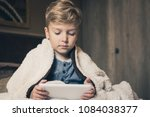 little boy watching cartoons... | Shutterstock . vector #1084038377
